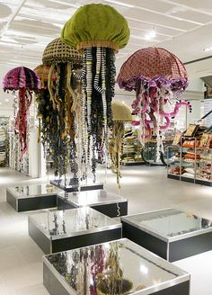 John Lewis installation by Chameleon Visual Limited. Jelly fish sculptures for ocean week - use open umbrellas!