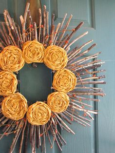 Autumn sunshine wreath, with fabric rosettes. From Yellow Mums.