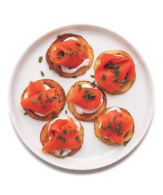 Smoked Salmon Potato Bites | Though this delicacy often appears on brunch menus, it's easy to serve smoked salmon at home—at any time of the day. From potato bites and canapes to sandwiches and salads, these smoked salmon recipes are perfect for entertaining or even a quick lunch.