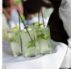 Mojito      What You Need      Handful of mint leaves  3/4 oz. fresh squeezed lime juice  3/4 oz. simple syrup*  1 1/2 oz. light rum  Club soda  Lime wedge, for garnish        How to Make It      Muddle mint leaves in lime juice and simple syrup.  Add ice and rum and shake briefly.  Pour ingredients into highball glass.  Top off with club soda.  Ga ...