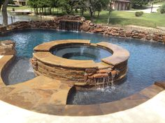 Superior pools www.superiorpoolsswfl.net Spa with rock spillway ...