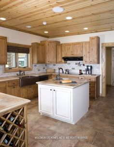 Wisconsin Log Homes - cooktop on the island