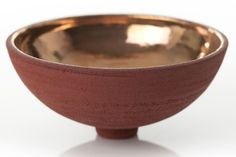 """Porcelain Red Bowl with Gold Lustre by Kerry Hastings from Bespoke Global, 4.7"""" h. x 9.8"""" dia.; $356. bespokeglobal.com"""