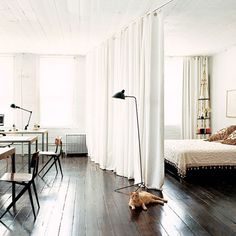 I love the use of curtains in the home as room dividers, alternative to closet doors, etc.  Perfect for the winter months to keep things cozy and the cold at bay.