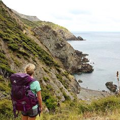 The rugged coastline scenery of the Cape Brett Track #NewZealand featuring @macpac Torlesse pack #whateveryouradventure - @theglobalcouple on Instagram