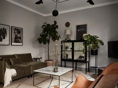 Other than the range of grey wall colors (from light grey in the living room, to darker grey in the bedroom to almost black in the kitchen) that look absolutely great in this home, I'm very much drawn to the excellent … Continue reading → Grey Wall Color, Wall Colors, Interior Exterior, Interior Architecture, Interior Design, Dark Walls, Grey Walls, Living Room Scandinavian, Scandinavian Interior