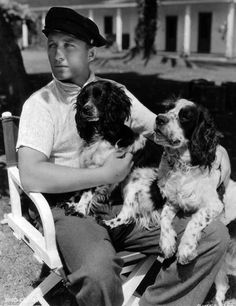 0 Bing Crosby with 2 dogs on his lap