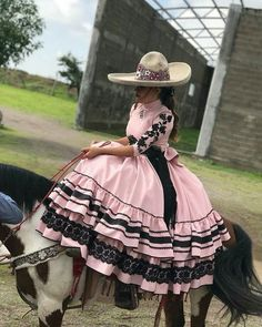 Image may contain: one or more people, hat and outdoor Quince Dresses, 15 Dresses, Girls Dresses, Mexican Outfit, Mexican Dresses, Traditional Mexican Dress, Traditional Dresses, Charro Outfit, Charro Dresses