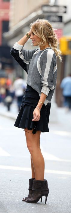 Mary Seng is wearing a jumper from Helmut Lang skirt from Tibi and the boots from Pedro Garcia