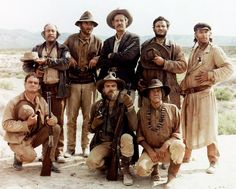 THE WILD BUNCH - Standing (l.) - Strother Martin - Unknown - Robert Ryan - Bill Hart - L. Jones - Center kneeling - Kneeling (l.) - Bo Hopkins - Unknown - Unknown - Directed by Sam Peckinpah - Warner Bros. Western Film, Western Movies, Ride The High Country, Bo Hopkins, Strother Martin, Warren Oates, 1969 Movie, The Mask Of Zorro, Eight Movie