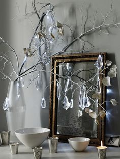 "Vintage chandelier drops on twigs."".I've got a bunch of these....what a simple & beautiful idea."