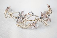 This radiant bridal headpiece will compliment any bride wear the popular pink colors for her wedding! This vine design of ivory pearls, round rhinestones in gold and rose gold leaves will look stunnin