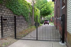 I need a clean, attractive double swing gate for the driveway. I don't want wood because I want the dogs to be able to see through if they want to. Black chain link at 6' high is also a possibility if a simple and clean wrought iron or aluminum is too pricey.