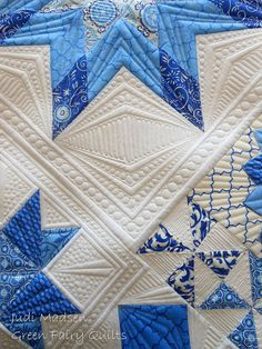 White Quilt with Blue Patterned Stars - quilting ideas