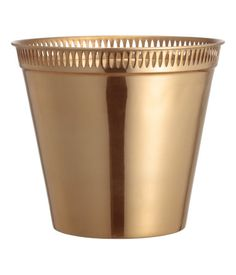 Gold-colored. Large metal plant pot with a decorative, perforated pattern at upper edge. Height 8 1/2 in., diameter at top 9 1/2 in.