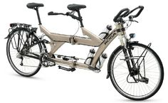 """This is a Koga TwinTraveller tandem folding bike made in Holland.  The TwinTraveller model was first introduced in 2000 as a non-folding bicycle and it won """"Bike of the Year"""" that year at a trade show in Amsterdam.  The folding version appeared in 2005 and is still produced as of 2014.  It has full-suspension, which is uncommon for a tandem folding bike, and features 27-speeds, a rear hydraulic disc brake and weighs in at 29.1kg (64 lbs).  MSRP as of 2014 is $6700.00 USD."""
