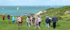 Enjoy a walk to the most southerly point of the Isle of Wight at the National Trust's St Catherine's Down. Out To Sea, Isle Of Wight, Old Postcards, Dog Friends, Dolores Park, Places To Visit, Coast, Island, Landscape