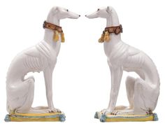 A pair of Italian polychrome decorated faience greyhounds, H