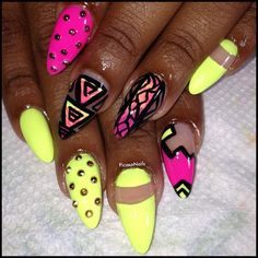 Dope Nails Neon yellow and pink with black details and studs, almons shape gel nails