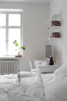Best All White Room Ideas White Clean Bedroom Shelves Bedding 35 all-white room ideas. Discover photos of living rooms, bedrooms, kitchens, and bathrooms decorated in all white decor. Find monochrome white rooms that will inspire your own decor. Bedroom Workspace, Clean Bedroom, Shelves In Bedroom, Home Bedroom, Bedroom Decor, White Desk In Bedroom, Master Bedroom, Bedroom Cupboards, Bedroom Simple