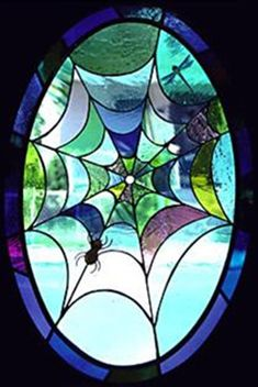 The window is composed of hand blown glass and is located in the front door of a stunning Victorian home.-Daniel Maher Stained Glass - Spiderweb