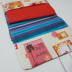 passport case -- Could make with an Irish type scene-- sheep, thatch cottage -- sell in tourist shops or airport.