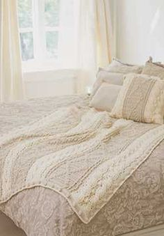 """Soft Neutrals Textured Afghan - Subtle crocheted texture gives this blanket and pillow and heirloom feel.   MEASUREMENTS: Afghan: Approx 46½ x 56""""; Pillow: Approx 16"""" square  MATERIALS: Patons Decor Yarn(100 g) Afghan: Main Color (MC): (Aran) 7 balls;Contrast A: (Ecru) 7 balls  Pillow: Main Color (MC): (Aran) 3 balls;Contrast A: (Ecru) 1ball  Size I/9/5.5mm crochet hook; 16"""" square pillow form; 5 buttons for Pillow. free pdf from Patons Yarns"""