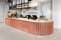 techne mixes natural, graphic and brass elements inside poacher & hound café in australia