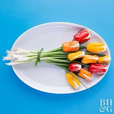 Stuff mini sweet peppers with herb-laced cream cheese for a showy spring appetizer that blooms with flavor. ••Would definitely omit the butter as it makes no sense whatsoever.