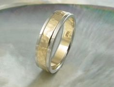 5mm two tone hammered wedding band for men or women in 14k gold with stepped edges. via Etsy.