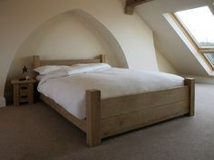 The Riven Oak Loft bed is a stunning addition to any bedroom, and great if you're short on space! This oak futon-style bed is handmade from solid oak timbers and is constructed using traditional mortice & tenon joints. The 'low footend' design lets you have a two-plank high footend but at the same time helps keep your room open and spacious.