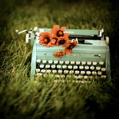 Pretty green typewriter (vintage) with flowers. Love this shot.