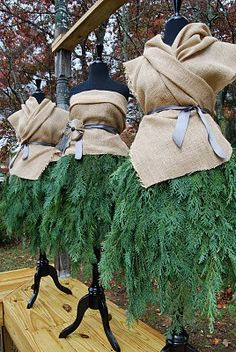Evergreen skirt and burlap top.  Genius window display idea for Christmas 2014.