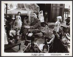 Margaret O'Brien The Secret Garden 1949 - Cornell boudoir doll next to bed, standing beside Deanna Durbin doll