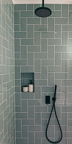 Contemporary bathroom with black faucets, tiles in a herringbone pattern. - Contemporary bathroom with black faucets, tiles in a herringbone pattern. Rain and hand shower and built-in niche for your shower supplies. Bathroom Renos, Bathroom Faucets, Small Bathroom, Bathroom Black, Bathroom Cabinets, Concrete Bathroom, White Bathrooms, Luxury Bathrooms, Master Bathrooms