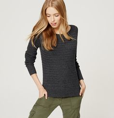 A basketweave knit turns up the textural appeal of this wear-everywhere sweater. Round neck. Long sleeves. Side slits. Ribbed neckline, cuffs and hem.