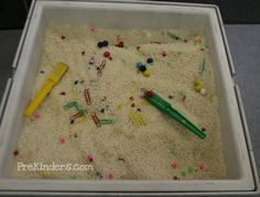 Fill the table with rice. Mix in some non-magnetic plastic beads (such as colorful pony beads), magnetic marbles, and colored metal paper clips. Include a magnet wand for each child. Children explore with the magnets in the sensory table, discovering which items are magnetic and which are not, and using the magnet wands to find buried magnetic treasure.