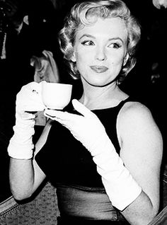 Marilyn Monroe feeling perky !  :) Classy while drinking coffee! love it http:/www.katiek.myorganogold.com