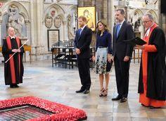 Queen Letizia wore Carolina Herrera silk taffeta blouse and Carolina Herrera Flower Fil Coupe Party skirt. Carolina Herrera Sandals
