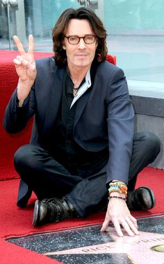 A spexy Rick Springfield, in dapper glasses, flashed the peace sign as he posed with his star on the Hollywood Walk of Fame!
