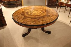 An exquisite Victorian Period burr walnut & floral marquetry antique centre/loo/dining table
