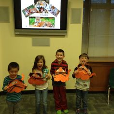 """Check out these """"ferocious"""" kids at last night's Big Cat Safari-themed storytime! If you want to join these 4-7 year olds on Wednesday nights, register at emmaclark.org."""