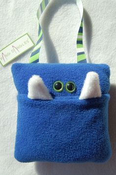 Tooth fairy pillow.  kinda like the monster too.  Funny looking for the boy.