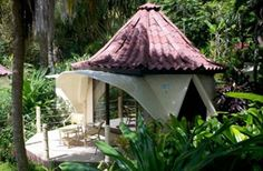 Ylang Ylang Resort, Montezuma, Costa Rica. Not easy getting there, but this small town (maybe 4 blocks) has an Apple-computer cafe, vegan/vegetarian restaurant and geodesic domes on the beach. Beach is a bit rocky, but this is Out There, plus you have the blue haired mohawk surfers on dirt bikes from Mal Pais zooming thru. Delightful gardens and pool and howler monkeys and bliss.