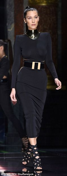 Working it: Earlier Stella and Bella were glam in Balmain's new collection on the catwalk, with Stella rocking head to toe nude while Bella went braless in a curve-hugging midi dress