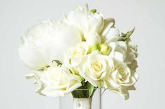 The bouquets are unstructured and natural with flowers in the shades of ivory, blush, pink, peach and buttery yellows. Popular flowers are Peonies, Garden Roses, Ranunculus, and Anemones.