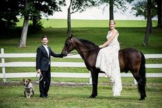 This wedding horse is such a good boy as the bride sits bareback in her wedding dress for a photo with her groom and dog for a summer Upstate, NY wedding!
