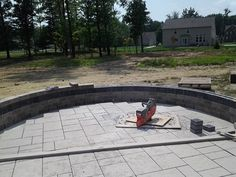progress and completion for the North Royalton job consisting of new front beds and planting, new multi-level patio with fire pit and seating wall, lighting, new trees and beds in rear, all new hydro seed lawn.  These photos are the original concept rendering and  preparation of the surfaces for pavers.
