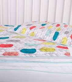 beautiful colorful bed sheets in fancy style -  feathers