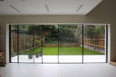 The Modern Sliding Patio Doors Minimal Windows As Modern Patio Doors In London Iq Glass House Interiors Awesome design interior simple and elegant with covers ideas DIY and lowes patio design interior and exterior Aluminium Sliding Doors, Modern Sliding Doors, Sliding Patio Doors, Folding Doors, Entry Doors, Wood Doors, Sliding Glass Doors, Bi Fold Doors, External Sliding Doors